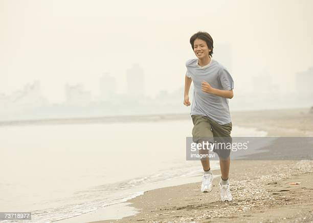 Boy running along the beach