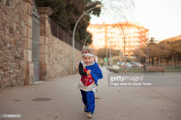 boy running dressed as a prince - reality kings stock pictures, royalty-free photos & images