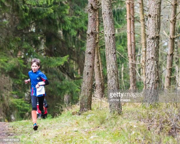 Boy running in forest