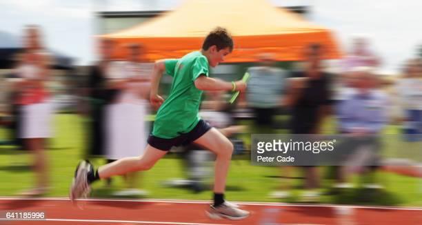 Boy running in race