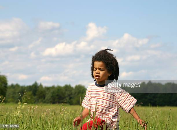 Boy running in the meadow