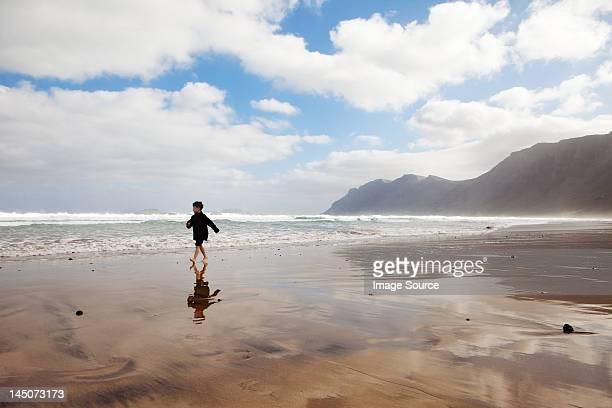 Boy running on a beach