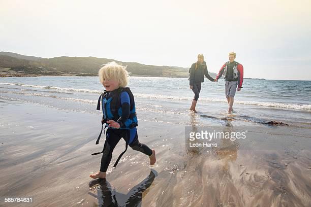 Boy running on beach, Loch Eishort, Isle of Skye, Hebrides, Scotland