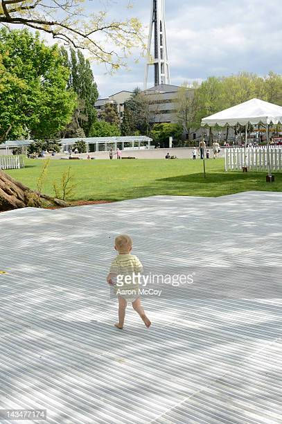 Boy running on plastic flooring in a park