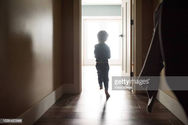 boy running out of room - baby boys stock pictures, royalty-free photos & images