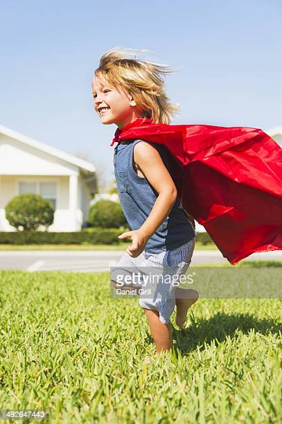 Boy (4-5) running with cape, Jupiter, Florida, USA