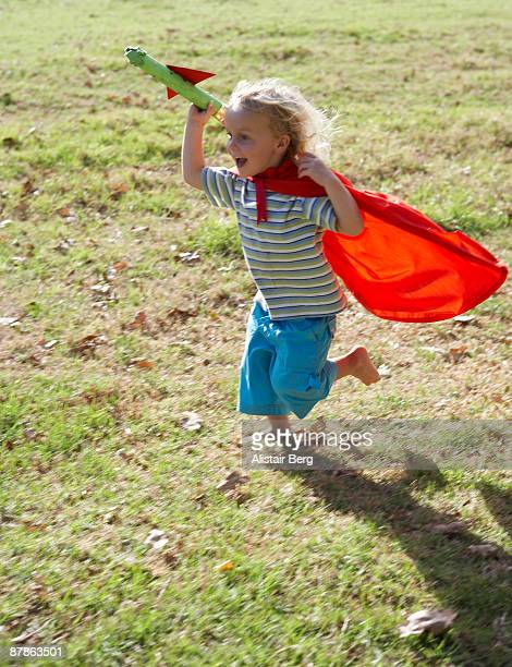 Boy running with homemade rocket