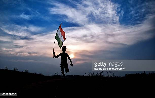 boy running with indian flag - indian flag stock pictures, royalty-free photos & images