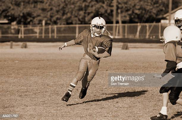 Boy Running with the Football