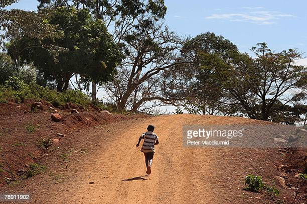 A boy runs along a dirt road on January 12 2008 in Kogelo western Kenya Barack Hussein Obama father of US presidential candidate hopeful Obama was...