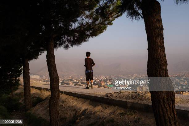 A boy runs along a wall at the top of Bibi Mahru Hill in Kabul Afghanistan on Sunday July 15 2018 Photographer Jim Huylebroek/Bloomberg via Getty...