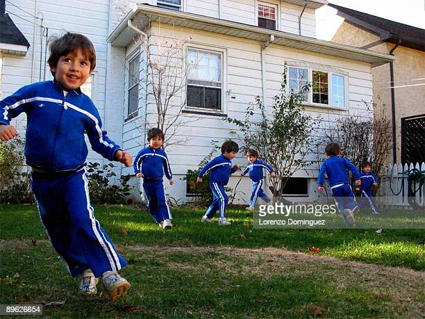 boy runs around with his clones - repetition stock pictures, royalty-free photos & images