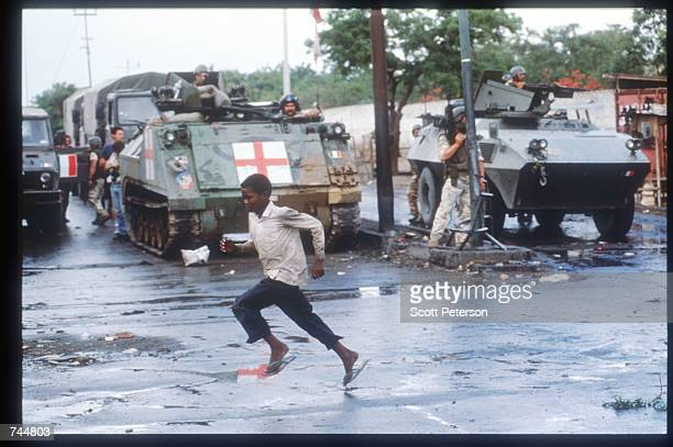 A boy runs June 20 1993 in Mogadishu Somalia An estimated 350000 Somalis died due to war famine and disease over the previous year