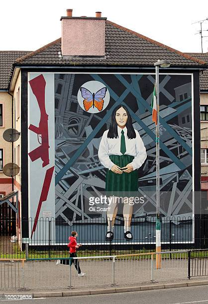 Boy runs past a mural in the Bogside area of Londonderry close to where the Bloody Sunday killings took place in 1972 on June 14, 2010 in...