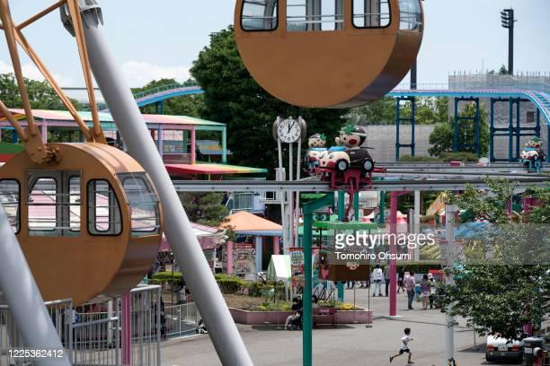 Boy runs through the Tochinoki Family Land amusement park on May 17, 2020 in Utsunomiya, Tochigi, Japan. Japan's Prime Minister Shinzo Abe announced...