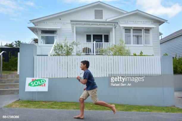 boy runs towards his new home - rafael ben ari imagens e fotografias de stock