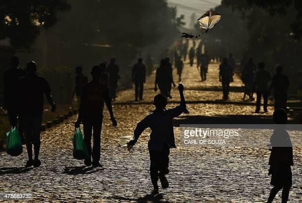 Boy runs with a kite in Bujumbura on June 3, 2015. AFP PHOTO/Carl de Souza