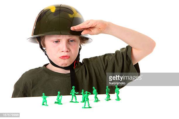 boy saluting green army men