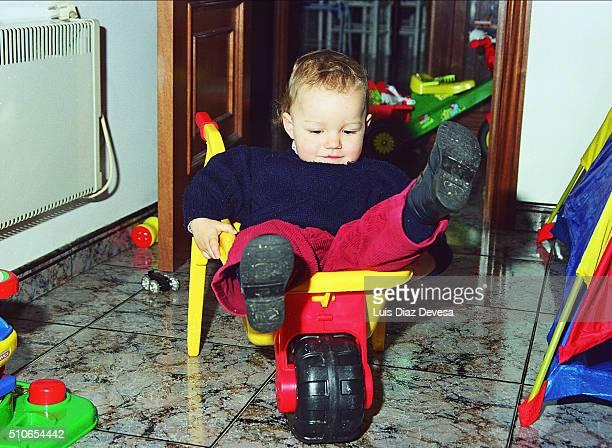 boy sat in a wheelbarrow