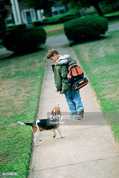 Boy saying goodbye to his dog