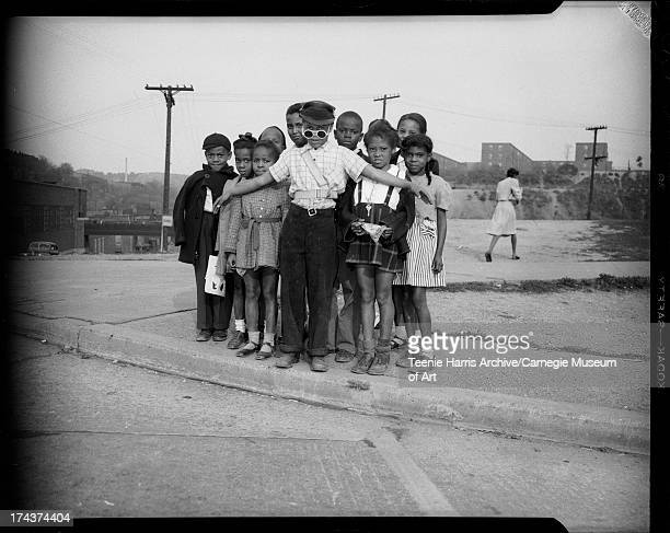 Boy school crossing guard holding back group of children including Donald Christmas Joann Collins Elaine Robinson Kenneth Holiday Curtis Andrews...