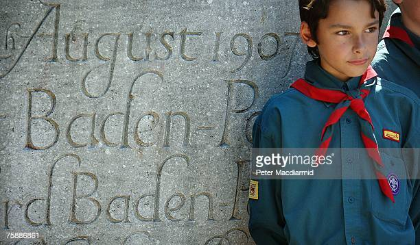 A Boy Scout from Surrey stands at a memorial stone marking the site of the first ever Scout camp on July 31 2007 in Sandbanks on Brownsea Island...