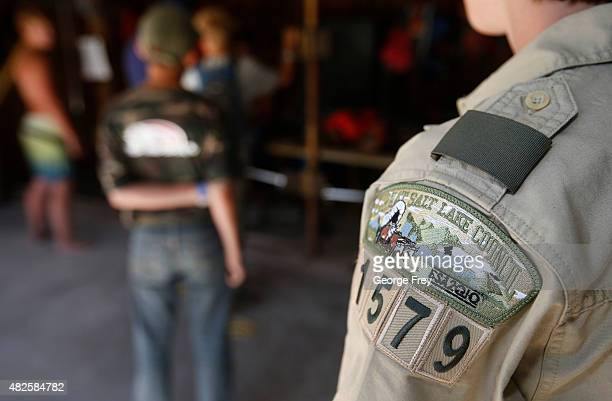 Boy Scout from the Salt Lake Council stands in line to get a canoe at camp Maple Dell on July 31 2015 outside Payson Utah The Mormon Church is...