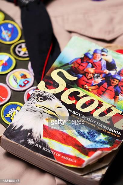 boy scout handbook, merit badge sash & neckerchief - handbook stock photos and pictures