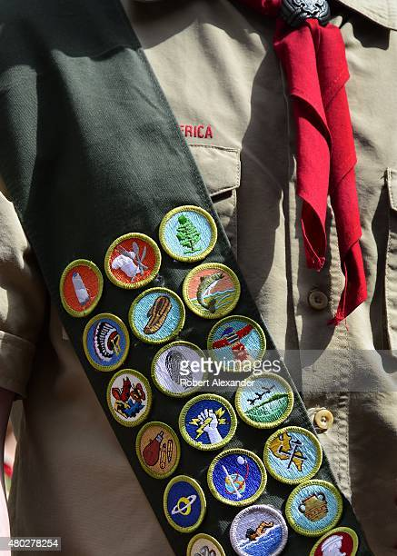 Boy Scout wears a sash displaying his earned merit badges at a ceremony in New York City. The merit badge sash is worn by a Boy Scout during formal...
