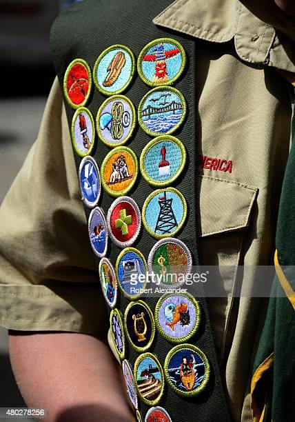 Boy Scout wears a sash displaying his earned merit badges at a ceremony in New York City The merit badge sash is worn by a Boy Scout during formal...