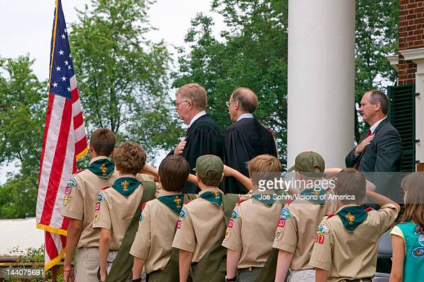 Boy Scouts and judge saying the Pledge of Allegiance with 76 new American citizens at Independence Day Naturalization Ceremony on July 4 2005 at...