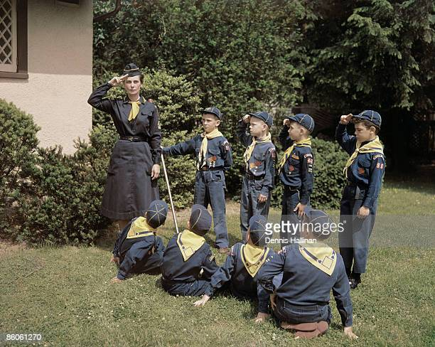 Boy scouts conducting meeting outdoors
