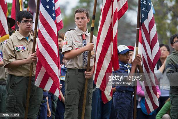 Boy scouts display US Flag at solemn 2014 Memorial Day Event Los Angeles National Cemetery California