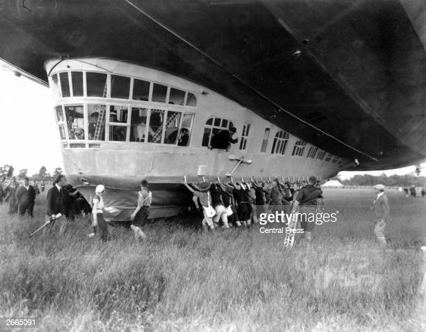 Boy scouts help with the landing operation of the Graf Zeppelin LZ 127 airship at Hanworth Middlesex
