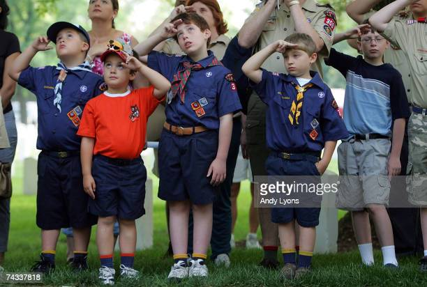 Boy Scouts salute the raising of the flag at Zachery Taylor National Cemetery on May 26 2007 in Louisville Kentucky Boy Scouts from the Seneca...