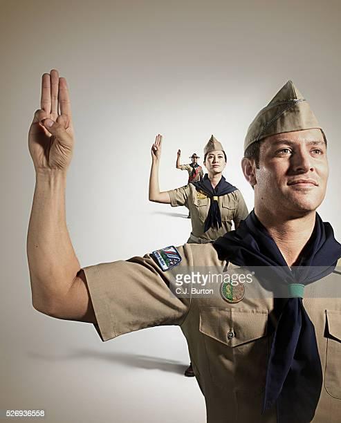 boy scouts saluting - pfadfinder stock-fotos und bilder
