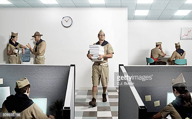 Boy scouts working in office