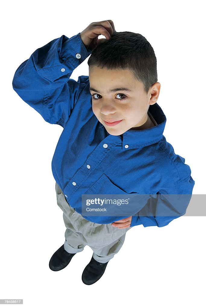 Boy scratching his head : Stock Photo