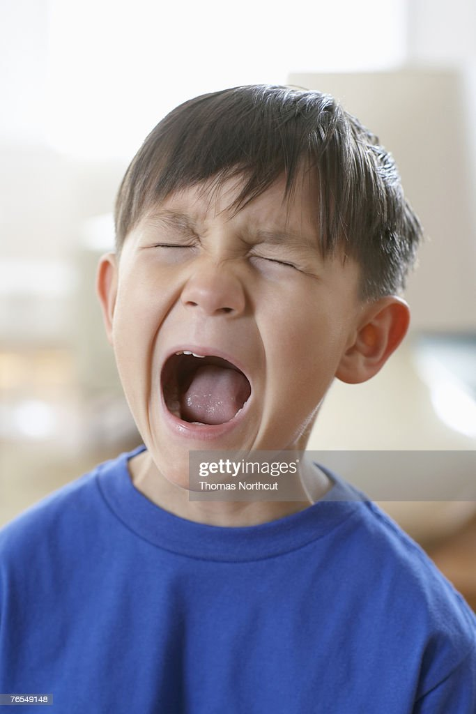 boy screaming closeup stock photo getty images