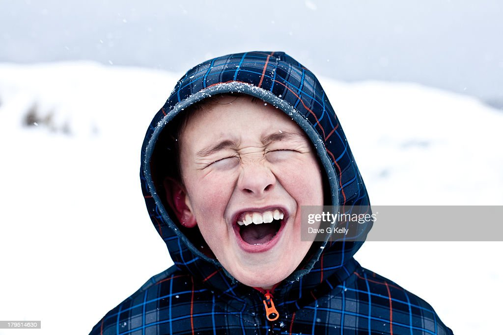 boy screaming in the snow stock photo getty images