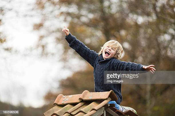 Boy screaming outdoors