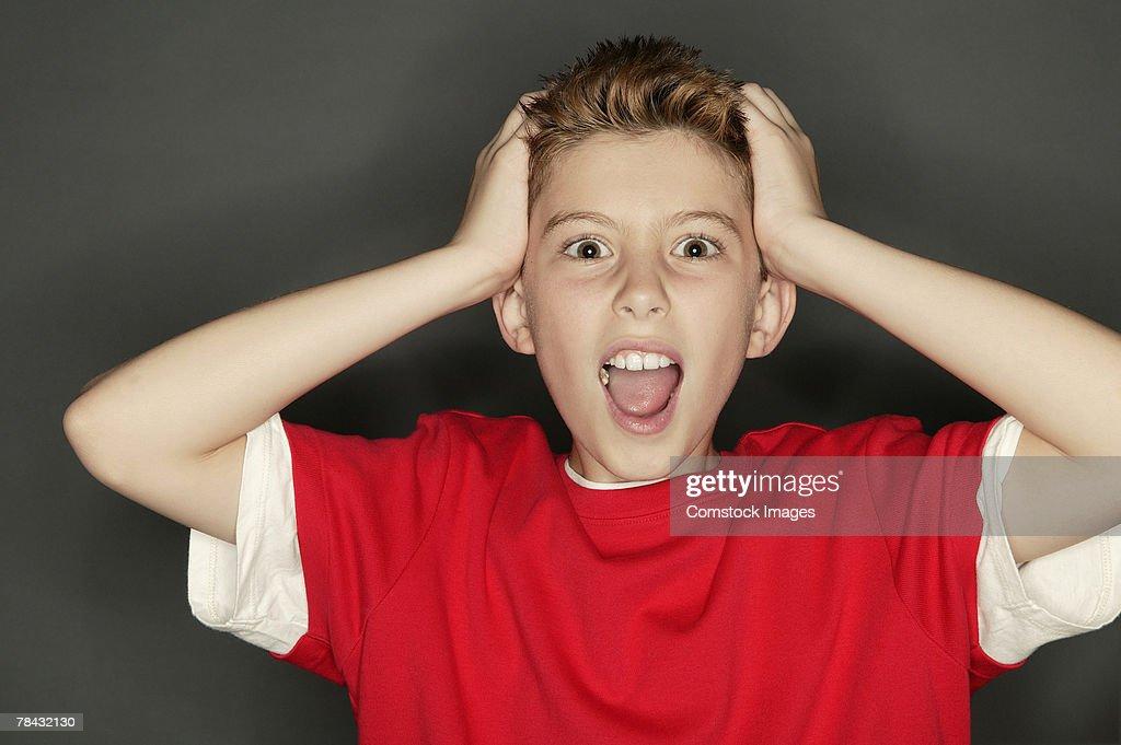 Boy screaming : Stock Photo