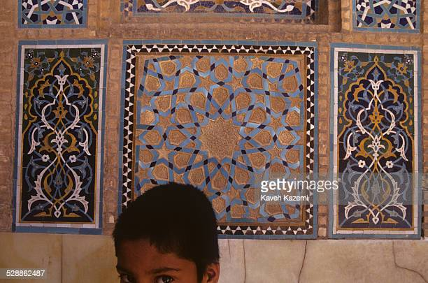 Boy seen in Juma mosquein the old town in Yazd, Iran on October 2, 1995.