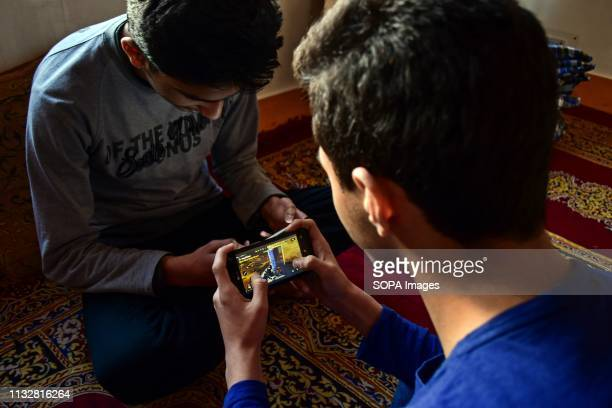 A boy seen playing PUBG game on his mobile phone in Srinagar Kashmir PUBG the game which has the youth glued to their phone screens has become a...