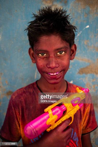 A boy seen with his water gun posing for a photo during the festival Holi known as the festival of colour is an ancient Hindu spring festival which...