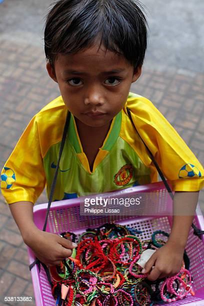 Boy selling jewelry on Sisowath quay