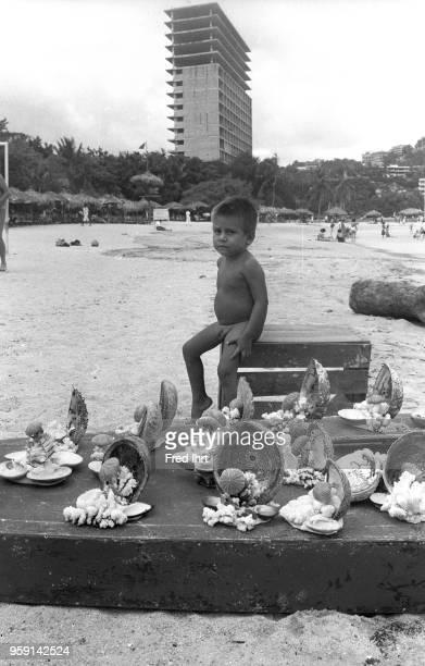 BEACH ACAPULCO GUERRERO MEXICO A boy selling sea shells on the beach