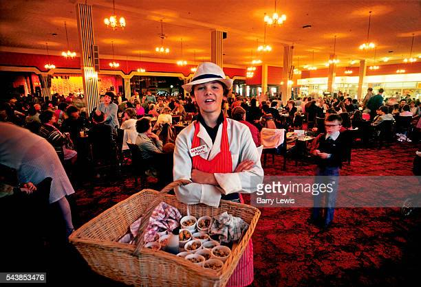 Boy selling seafood in the bar at Butlins holiday camp Skegness Butlins Skegness is a holiday camp located in Ingoldmells near Skegness in...