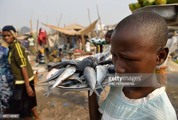 A boy sells fishes in the displaced camp near Mpoko airport on January 15 2014 in BanguiFew people are going back home as the situation is more quiet...