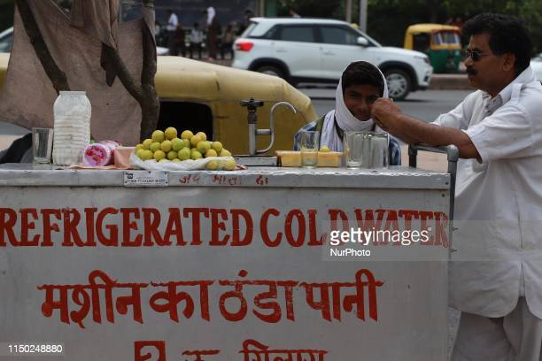 Boy sells Refrigerated cold water on a hot summer day in New Delhi on 15, June 2019